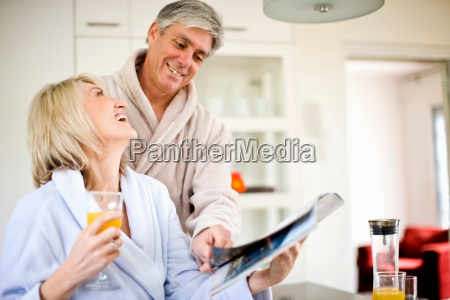 couple reading magazine at breakfast