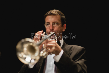 trumpet player in orchestra