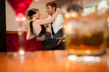 smiling couple dancing in bar