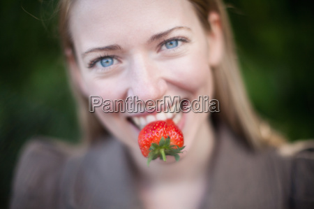 close up of strawberry in womans