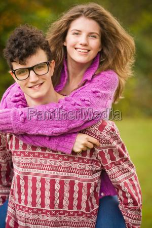 teenage couple hugging in park