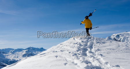 male skier standing on top of