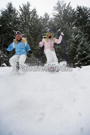 two young blonde women walking down