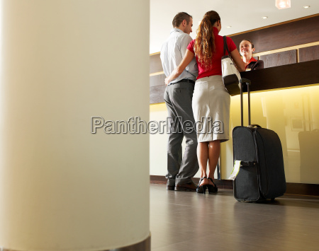 couple standing at hotel reception