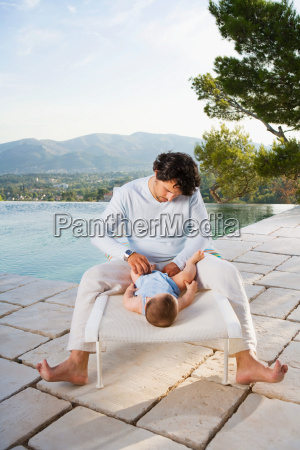 man changing a babys diaper
