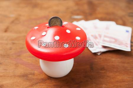 close up of mushroom savings bank