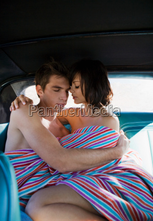 man and woman on backseat of