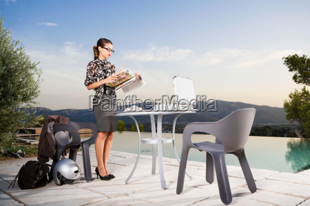 woman at patio table working by