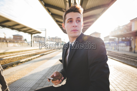 portrait of young businessman commuter sitting