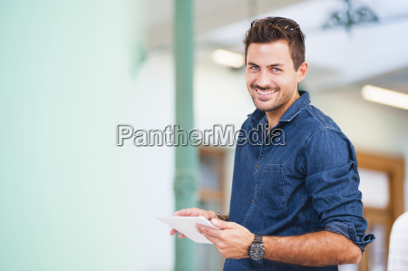 portrait of handsome young man using