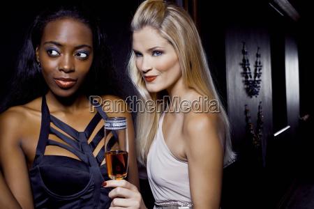 two female friends watching in nightclub