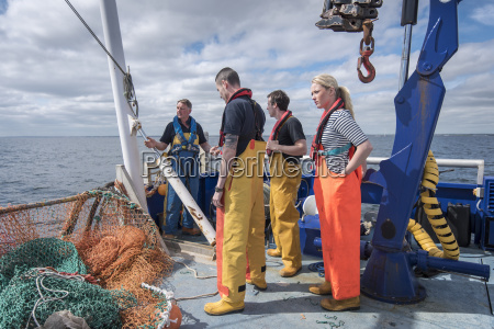 research scientists on deck of research