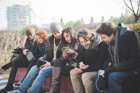 six young adult friends networking on