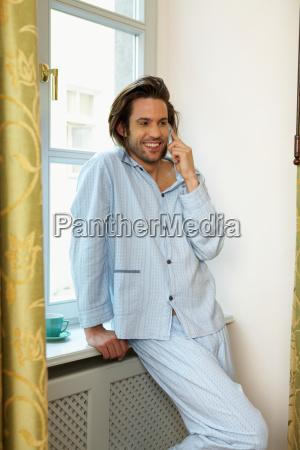 young man smiling wearing pyjamas
