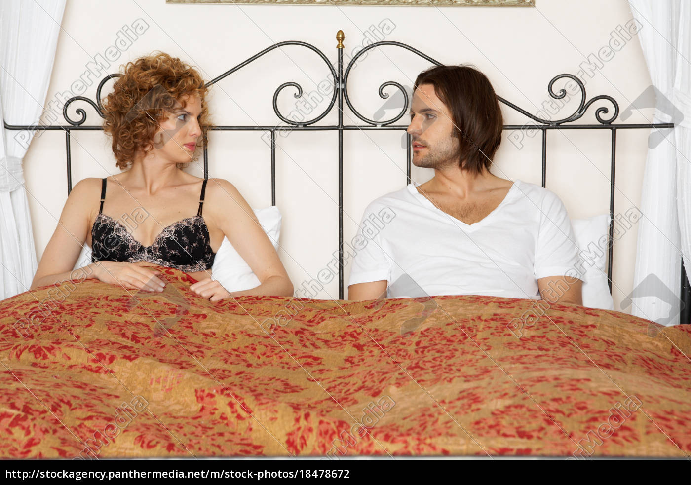 young, couple, sitting, in, bed - 18478672