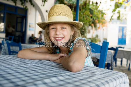 young girl at an outdoor restaurant