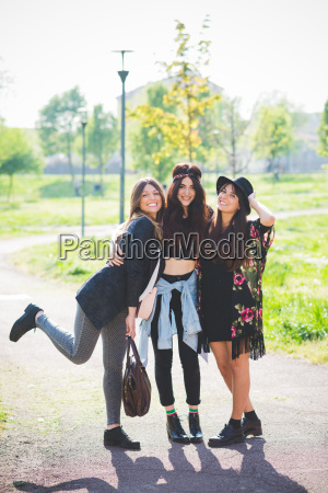 portrait of three stylish young female