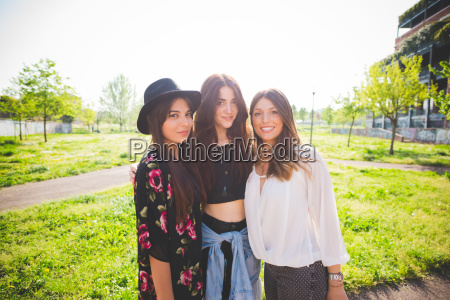 portrait of three young female friends