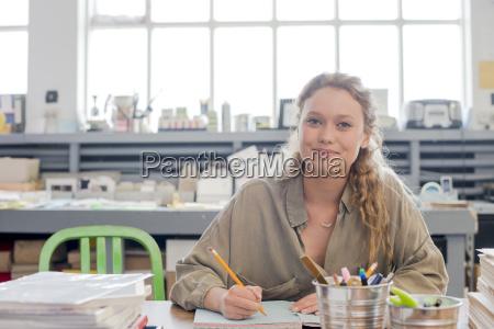 portrait of female print designer working