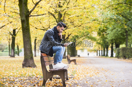 young man using digital tablet on