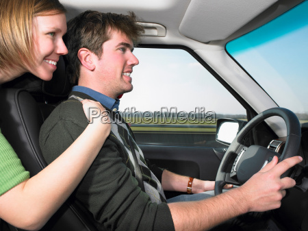 young woman hugging driver