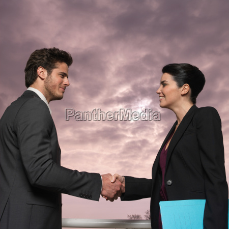 couple outdoors shaking hands