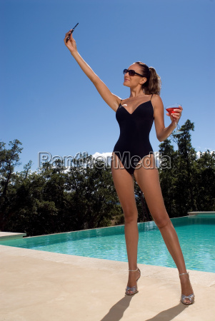 woman standing beside a pool