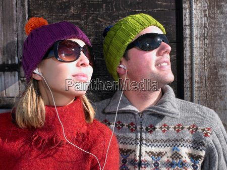 couple listening to music at chalet