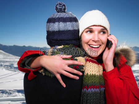 man hugging woman on phone