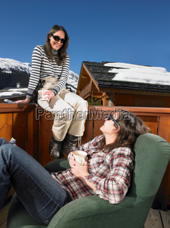 young women chatting on terrace