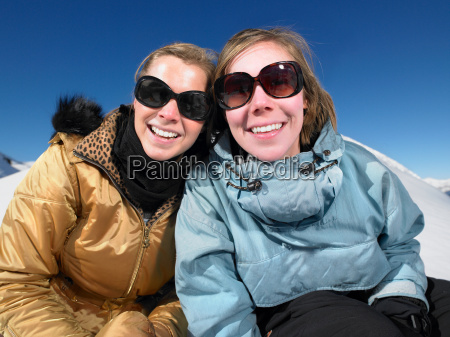 smiling young women in snow