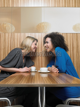 two young adult women talking