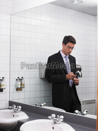man reflected in office mirror