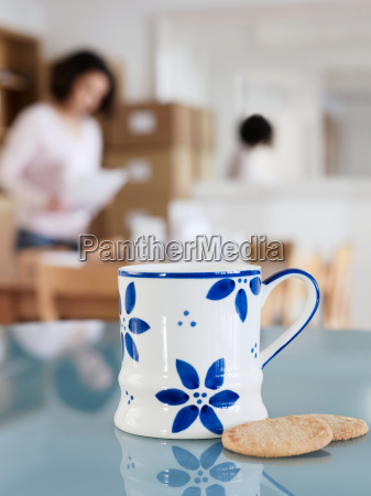 cup and biscuits on office table