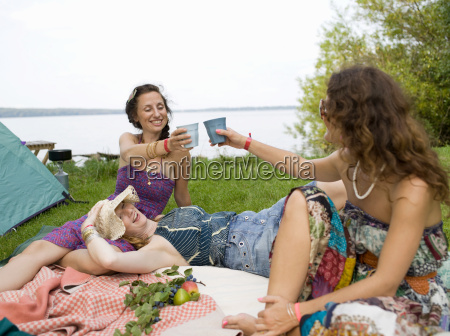 three women on blanket in front