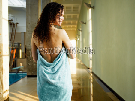 woman wrapped in towel rear view