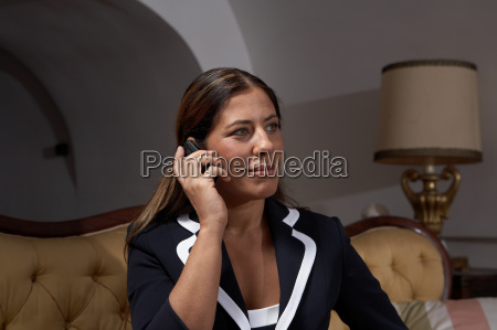 woman using mobile phone indoors