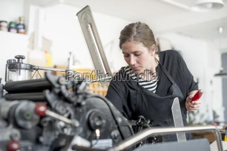 female printer preparing print machine in