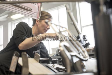 female printer preparing machine in workshop