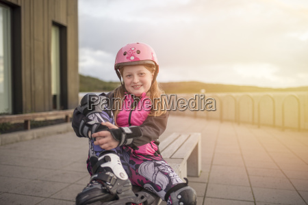 portrait of young girl wearing rollerblades