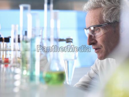 scientist preparing chemical experiment in laboratory