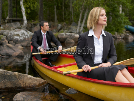 business couple in a kayak