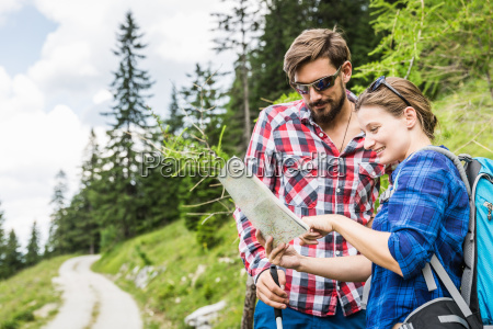 couple with map tyrol austria