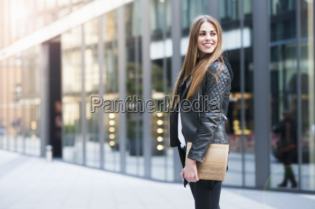 young woman carrying digital tablet looking