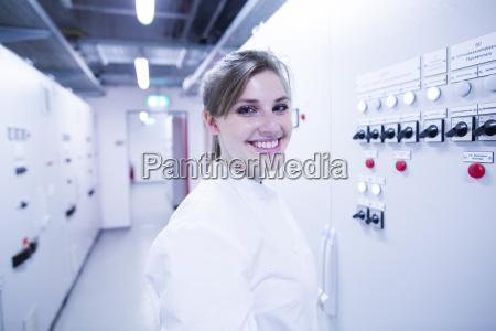 portrait of young female scientist next