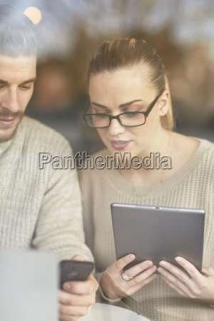 young man and woman sitting at