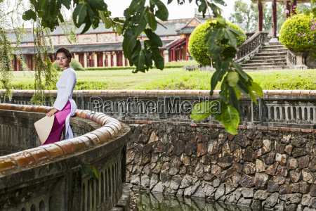 mid adult woman wearing ao dai