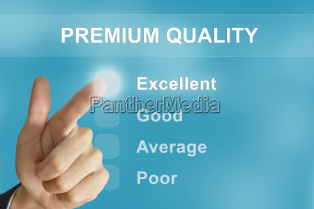 business hand pushing premium quality button