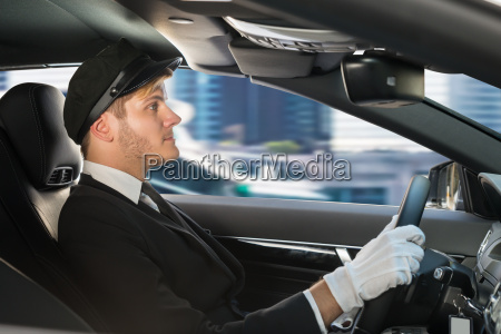 portrait of young chauffeur in car