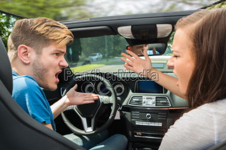 couple quarreling in a car